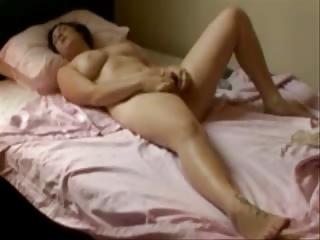 my wonderful mum fisting on her bed. hidden cam
