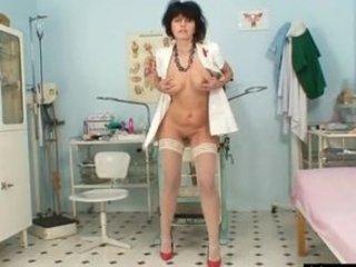 horny fresh mature babe wears latex uniform and