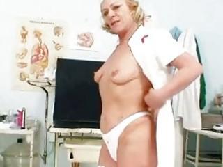 albino elderly nurse using gyno vagina spreader