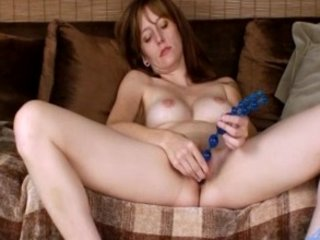 lady with beads pushing dildo her clit