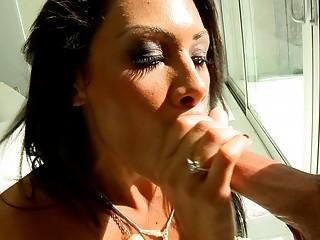 classy brunette woman gives fantastic fellatio