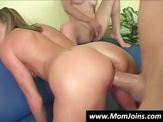 mother and daughter getting on one hard cock and