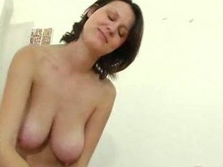 grownup lady with huge chest gives a handjob