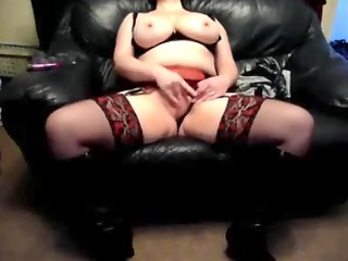 desperate woman on a leather armchair at house