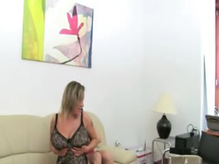 mature girl banging on leather sofa