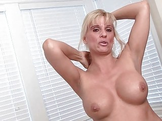 classy albino mature babe goes naked and pokes