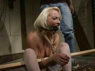 cougar blonde takes bondaged and punished